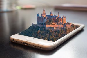 iPhone with castles rising from it
